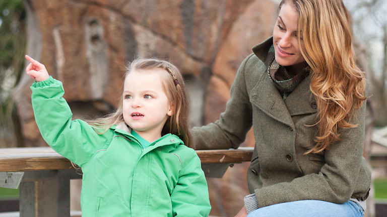 girl-pointing-with-mom_TS_118935255